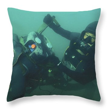 A Navy Seal Combat Swimmer Removes Throw Pillow by Michael Wood