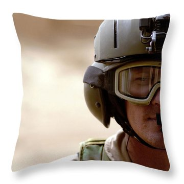 A Pararescueman Checks Throw Pillow by Stocktrek Images