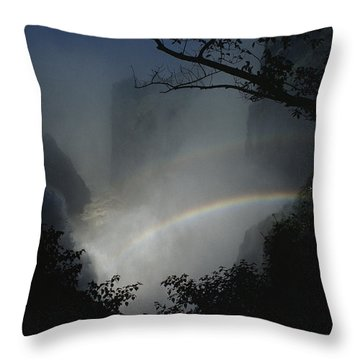 A Rainbow Arcs Across Victoria Falls Throw Pillow by James L. Stanfield