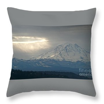 A Ring Of Bright Light Beside Mount Rainier Throw Pillow by Sean Griffin