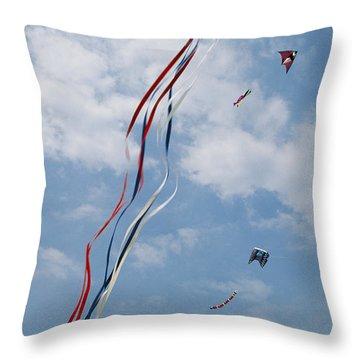 A Train Of Kites Flies At The Jockeys Throw Pillow by Stephen Alvarez