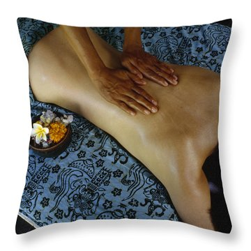 A Woman Receives A Traditional Balinese Throw Pillow by Justin Guariglia
