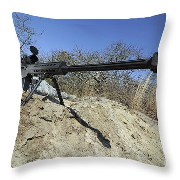 Airman Sights A .50 Caliber Sniper Throw Pillow by Stocktrek Images