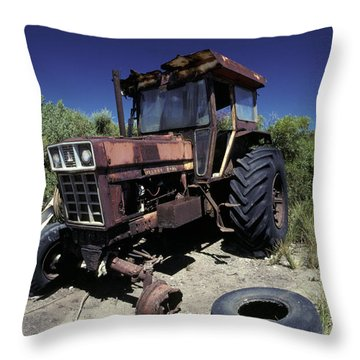 An Abandoned Tractor Rusts Away Throw Pillow by Jason Edwards