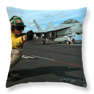 An Airman Gives The Signal To Launch An Throw Pillow by Stocktrek Images