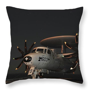An E-2c Hawkeye Is Chained Throw Pillow by Stocktrek Images