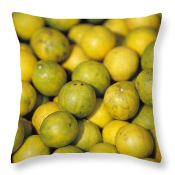 An Enticing Display Of Lemons Throw Pillow by Jason Edwards