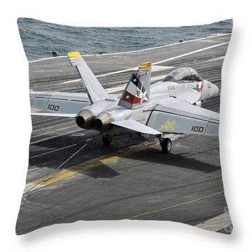 An Fa-18f Super Hornet Traps An Throw Pillow by Stocktrek Images
