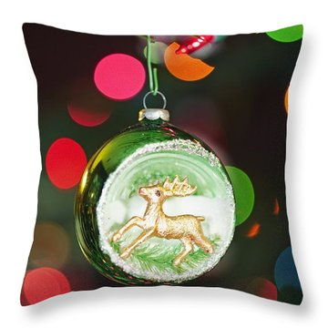 An Ornament With A Reindeer Hanging Throw Pillow by Craig Tuttle