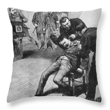 Anarchist Being Held Down For Mug Shot Throw Pillow by Photo Researchers