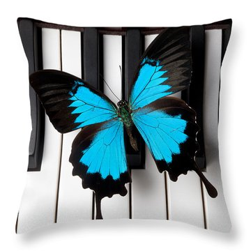 Blue Butterfly On Piano Keys Throw Pillow by Garry Gay