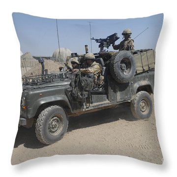 British Soldiers In Their Land Rover Throw Pillow by Andrew Chittock