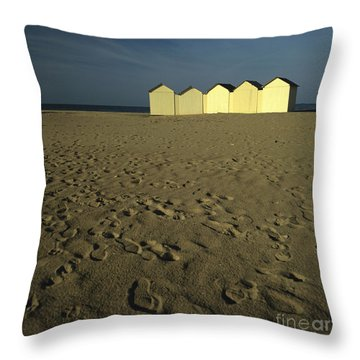 Cabins On A Beach In Normandy Throw Pillow by Bernard Jaubert