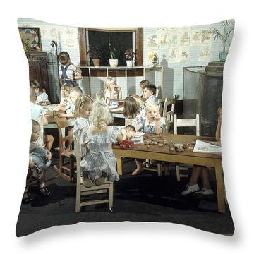 Children Play In A Day Nursery Throw Pillow by J. Baylor Roberts