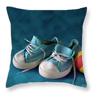 Children Sneakers Throw Pillow by Carlos Caetano