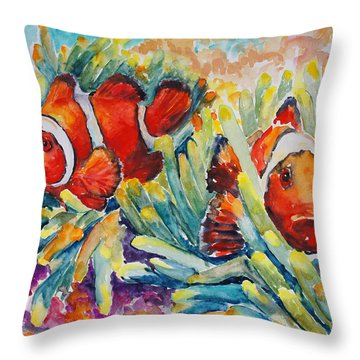 Clownfish In Their Paradise Throw Pillow by Barbara Pommerenke