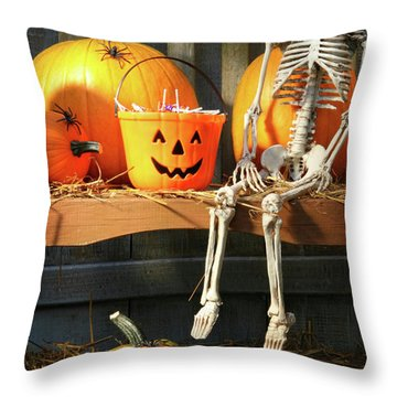 Colorful Pumpkins And Skeleton On Bench Throw Pillow by Sandra Cunningham