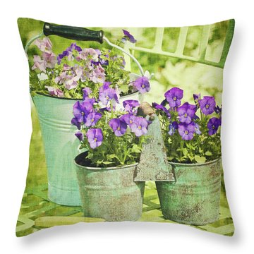 Colorful Spring Flowers On Garden Chair Throw Pillow by Sandra Cunningham