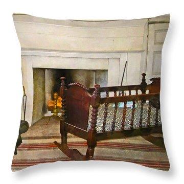 Cradle Near Fireplace Throw Pillow by Susan Savad
