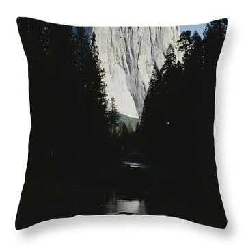 El Capitan Soars Above The Merced River Throw Pillow by Marc Moritsch