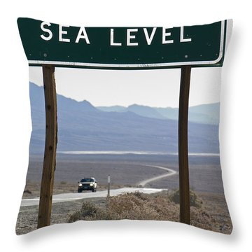 Elevation Sea Level Sign And Highway Throw Pillow by Rich Reid