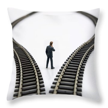 Figurine Between Two Tracks Leading Into Different Directions  Symbolic Image For Making Decisions Throw Pillow by Bernard Jaubert