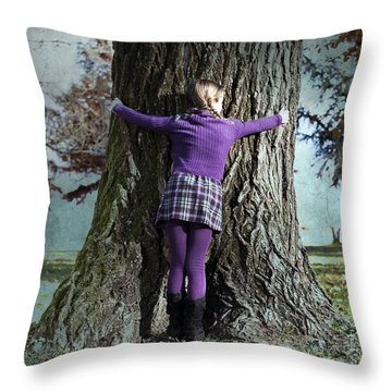 Girl Hugging Tree Trunk Throw Pillow by Joana Kruse