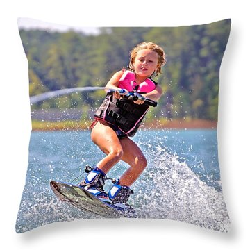 Girl Trick Skiing Throw Pillow by Susan Leggett