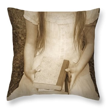 Girl With Books Throw Pillow by Joana Kruse