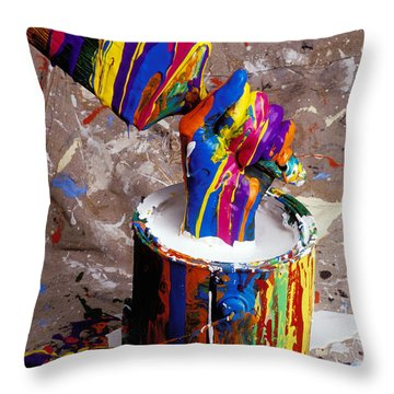 Hand Coming Out Of Paint Bucket Throw Pillow by Garry Gay