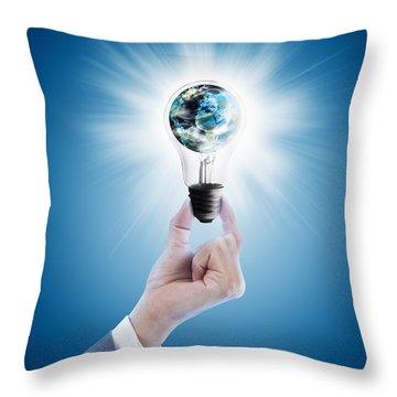 Hand Holding Light Bulb With Globe  Throw Pillow by Setsiri Silapasuwanchai