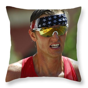 Ironman On The Run Throw Pillow by Bob Christopher