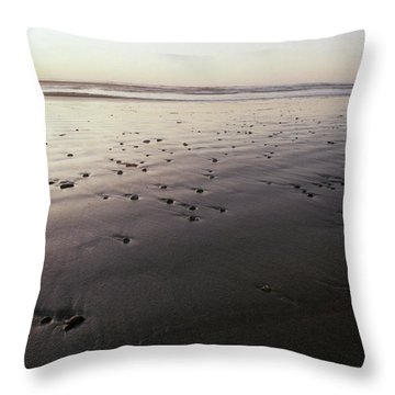 Pebbles Form Patterns On A Sandy Ocean Throw Pillow by Jason Edwards