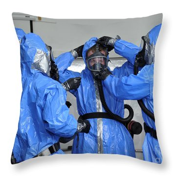 Personnel Dressed In Hazmat Suits Throw Pillow by Stocktrek Images