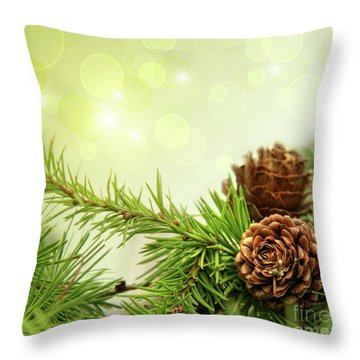 Pine Cones On Branches With Holiday Background Throw Pillow by Sandra Cunningham