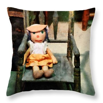 Rag Doll In Chair Throw Pillow by Susan Savad