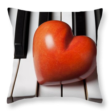 Red Stone Heart On Piano Keys Throw Pillow by Garry Gay