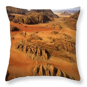 Rock Formations And Sand Near Petra Throw Pillow by Annie Griffiths