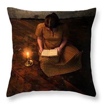 Schoolgirl Sitting On Wood Floor Reading By Candlelight Throw Pillow by Jill Battaglia