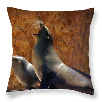 Sea Lions Throw Pillow by Carlos Caetano