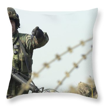 Soldier Calls Out Approaching Locals Throw Pillow by Stocktrek Images