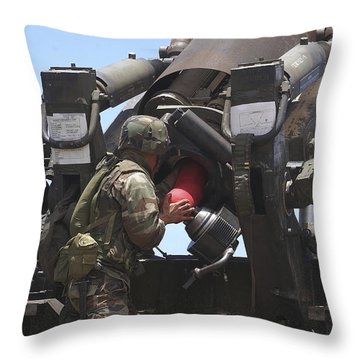 Soldier Loads A Charge Round Throw Pillow by Stocktrek Images