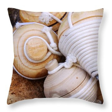 Spinning Tops Throw Pillow by Carlos Caetano