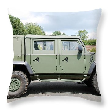 The Iveco Light Mulirole Vehicle Throw Pillow by Luc De Jaeger