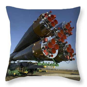 The Soyuz Rocket Is Rolled Throw Pillow by Stocktrek Images