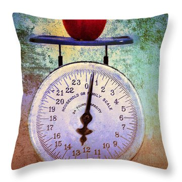 The Weight Of An Apple Throw Pillow by Tara Turner