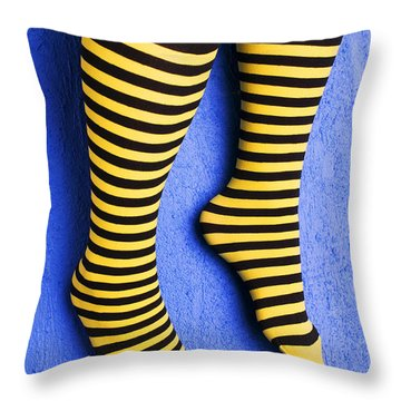 Two Legs Against Blue Wall Throw Pillow by Garry Gay