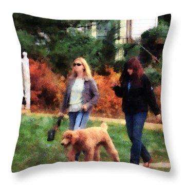 Women Walking A Dog Throw Pillow by Susan Savad