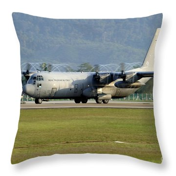A C-130j Hercules Of The Royal Throw Pillow by Remo Guidi
