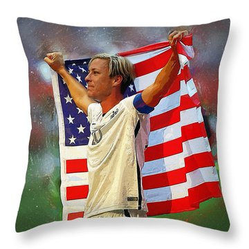 Carli Lloyd Throw Pillow by Semih Yurdabak